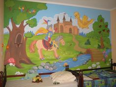 A knight on a horse, a castle, and a yellow dragon are all a part of this custom painted kids' room mural.