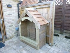 A Gothic Log Store finished with a natural wood stain and cedar shingle roof.
