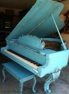 Play music in a sea of blue. Christian Kurtzmann piano, 1915.