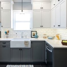 Custom shaker style cabinets topped with Quartz counters and a subway tile backsplash are the stars in our Chicago kitchen remodel. Contrasting lower base cabinets in BM Chelsea Gray help add interest. #remodel #kitchen #kitchendesign #kitchenremodel #interiordesign #interior #interiordesigner