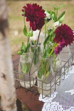 Burgundy dahlias in milk bottles | Victorian Inspired Fall Wedding In Deep Rich Hues of Burgundy, Gray, Ivory & Green | Photograph by Rebecca Keeling Studios  http://www.storyboardwedding.com/victorian-inspired-fall-wedding-deep-hues-vintage-line-drawing-art/