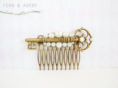 This elegant hair comb features a large antiqued golden bronze key with ornate design, finished with your choice of white ivory faux pearls  HOW TO ORDER:  * Choose white or ivory pearls - from the drop-down list above. * Add to cart, etc  DETAILS:  * Key measures approx 3 long * Low shipping (see below for shipping cost)   Your Fern & Avery hair accessories will always arrive beautifully gift-wrapped and in a sweet little organza giftbag, and carefully packaged to arrive safely.   Please...