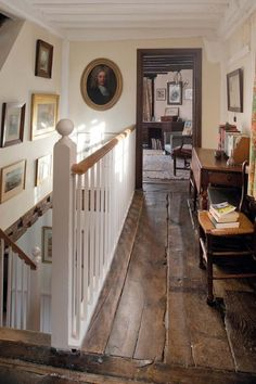 Brilliant old landing - great floor boards and pictures. Like the grey door frame too.