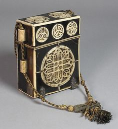 Medieval box for books/manuscripts, said to belong to Anne B. It is French and made from tortoise shell and ivory, an expensive item no doubt. The designs on it are very Celtic looking..