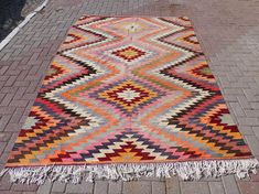 Check out this item in my Etsy shop https://www.etsy.com/listing/514774048/vintage-turkish-kilim-rug-turkish-rug