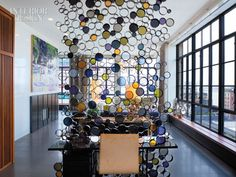 "How eye-catching is THIS?! From the website: ""To fabricate the screen,  artist Susan Woods sawed blackened-steel tube into segments, welded them together, and inserted rounds of  colored glass."" #bubbles #roomdivider"
