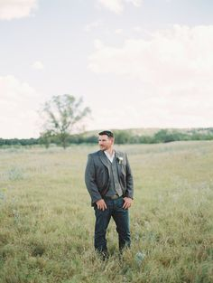 Casual, rustic elegant wedding groom's outfit idea - jeans paired with a tweed vest and jacket  {Charla Storey Photography}