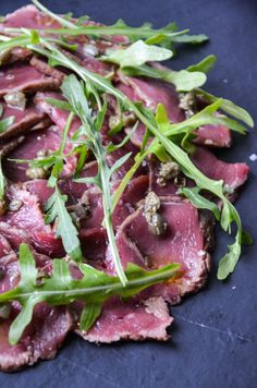 Venison carpaccio with a simple caper & olive oil dressing, perfect for an elegant dinner party dish or a wonderful light dinner shared between two.