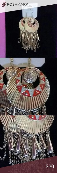 GOLD AND ORANGE HOOP TASSEL EARRINGS Gorgeous gold circle dangle earrings with chain and drop accents. Middle circle is crystals and orange geometric concentric circle surrounds it. Jewelry Earrings