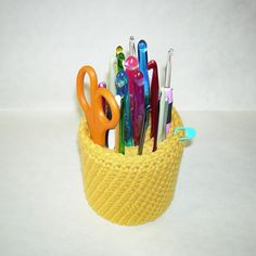 From the website: I crochet at my computer desk (don't we all?) and needed a better way to store the hooks I like to keep handy. I was keeping them in a pencil cup, and always had to remove all the hooks to find the one I wanted. This hook caddy has a coiled inner section that keeps the hooks separate for quick access…just insert the hooks between the coils!