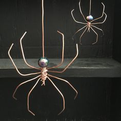 Copper wire spiders look great hanging anywhere in your home, no matter the season.