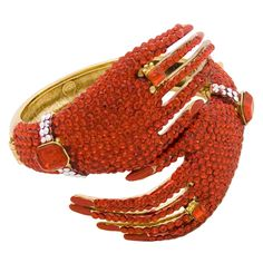 Look amazing with the unqiue and fabulous Butler & Wilson Swarovski Crystal Wrapping Hands Snap Bangle.