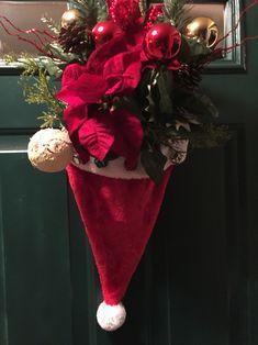 With the Santa Hat Door Hanger.