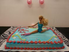 We couldn't find a gymnastics cake so we bought a cake at Walmart that was suppose to be fairy design. Then we put the dance Barbie in the middle instead!