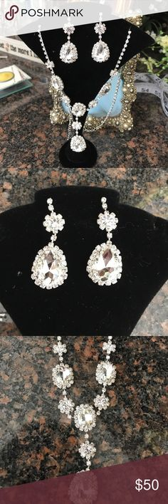 Rhinestone Bridal Jewelry Set nwt Gorgeous drop earrings and matching adjustable length necklace make this the perfect accent to your bridal gown or bridesmaid dress. Multifaceted so they sparkle in every light.  Earrings are 2 inch in length. Big stones are 3/4 inch wide at widest point. Jewelry