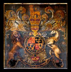 Royal coat of arms of George III in the Church of the Holy Trinity at Rothwell, Northamptonshire, England.  Check out the wily grin on that lion!