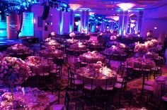 I like the alternating high low centerpieces - and I really like the lighting in this shot
