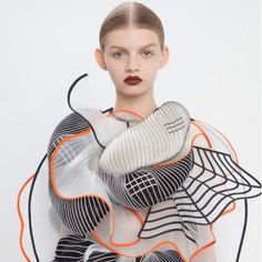 Noa Raviv combines grid patterns and 3D printing  for Hard Copy fashion collection