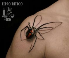 Realistic Spider tattoo on shoulder