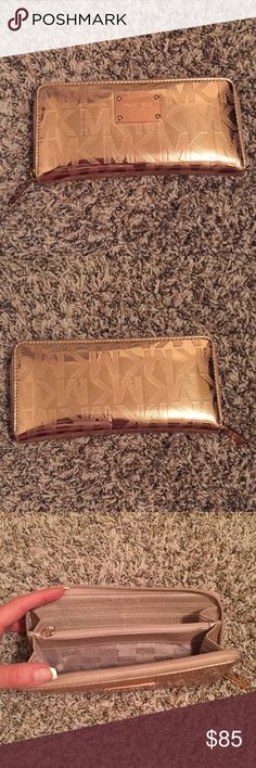 Wallet Michael Kors Gold wallet Michael Kors. Condition as new.  Michael Kors Bags Wallets