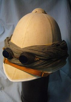 Vintage safari hat and goggles. The sands can blow when on safari. Steampunk Hat, Steampunk Clothing, Steampunk Fashion, Steampunk Costume, Pith Helmet, Vintage Safari, British Uniforms, British Colonial Style, Out Of Africa