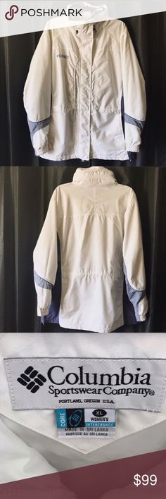 """COLUMBIA white blue raincoat utility jacket XL Columbia outerwear is a timeless classic. This is clearly a well-loved utility jacket. It may not be super stylish, but it sure does the job! Protects from harsh winds, rain, even moderate snow. Better than a spring trench coat. Has a sticky zipper (has buttons as an alternate) and some little stains that are barely noticeable (see pictures), but is in good wearable condition.  🌦❄️ Pit to pit 26.5"""" 🌦❄️ Sleeve 24.5"""" 🌦❄️ Shoulder 21"""" 🌦❄️…"""