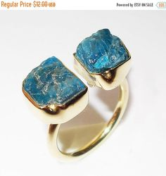 Rough Apatite Ring - Raw Stone Ring - Rough Gemstone Ring - Mineral Ring - 24K Gold Vermeil Ring - Adjustable Ring - Shiny Gold Plated Ring  Products Details  Item Code = AGRBR-986-B  Gross Wt. = 5.500 Gms  Gemstone: Apatite  Color: Blue  Metal: 24K Yellow Gold Overlay Brass  Ring size: 4-10  Our jewellery is made using natural stones therefore, the stones may slightly vary in shape,colour, and size.  Need another ring size? We would love to re-size it especially for you. Please mail us…