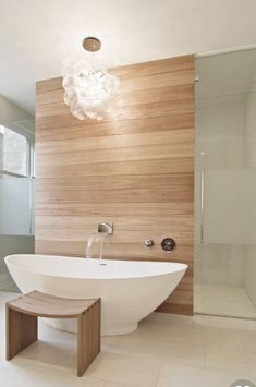 Bathtub With Waterfall Spout Coming Out Of Wall