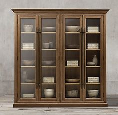 RH's 20th C. English Brass Bar Pull Glass 4-Door Cabinet:Evoking the character of turn-of-the-century English cabinets used by shopkeepers to display and store their wares, Dutch artisan Theo Eichholtz designed ours with a brass bar handle, elegantly molded cornice and plinth-style base.