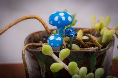 A personal favorite from my Etsy shop https://www.etsy.com/listing/221905394/glass-mushroom-set-for-fairy-gardens-or
