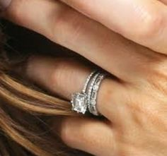 Kate Beckinsale's Love the single stone with layered bands.