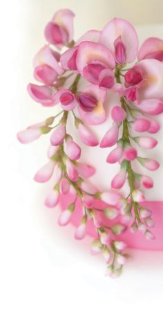 Pretty pink Japanese wisteria made with flower paste, perfect for a summer wedding.