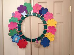 Teacher appreciation gift from class.  Each kid wrote a thank you note on a flower and decorated a clothespin.  Clothespins were glued to wreath.  Wreath can later be used to attach photos, notes, etc.