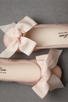 pale pink ballet flats with over-sized floppy ribbons