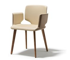 High-end Aye carver dining chair shown in two-tone leather hide