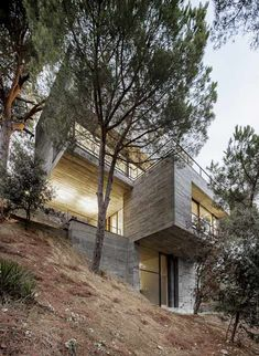 This house by Spanish architect Daniel Isern looks like a cluster of concrete cubes, stacked up on a steep hillside on the outskirts of Barcelona