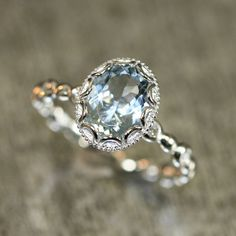 Floral aquamarine engagement ring from LaMoreDesign in pale blue