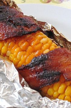 You'll never eat corn any other way! Ingredients 10 ears corn, husked and cleaned Cajun seasoning to taste salt and black pepper to taste 1 pound) package sliced bacon 10 sheets aluminum foil Instructions Preheat Grilled Bacon Wrapped Asparagus, Bacon Wrapped Corn, Corn Recipes, Side Dish Recipes, Vegetable Recipes, Easy Recipes, Veggie Food, Popular Recipes, Side Dishes
