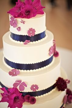Fuchsia and navy accents for a white wedding cake. Florals by freshdesign. Cake by The Cake Lady. Photography - m three studio