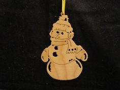 snowman ornament, you can visit my page @etsy. Enter DavesSawdustFactory. Thank you