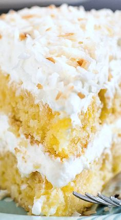 Pineapple Coconut Cake ~ Loaded with fresh pineapple and covered in a super fluffy whipped coconut frosting... It'll take you right to the tropics!