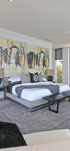 Modern bedroom - artwork that makes a statement and defines the feeling in this room. I LOVE THE ART WORK!