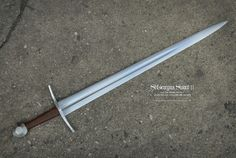 "14th Century Sword by Maciej Kopciuch. Overall length-40 1/3"" Grip-5.1"" Blade width~2.4"" Cross guard-8"""