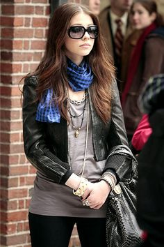 Georgina Sparks paired a skull necklace and houndstooth scarf with an edgy leather jacket, a simple tee and black leggings. (S1)
