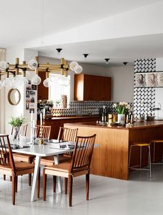 Encaustic tiles also as a backsplash. These ornate tiles are at once old-fashioned and coming-of-age.