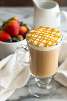 A completely homemade copycat Starbucks Caramel Macchiato recipe. Easy to make from scratch and absolutely delicious! The photos in this post have been updated. You're in the right place.) Some of the recipes I Starbucks Caramel Macchiato Recipe, Ice Caramel Macchiato, Homemade Mocha, Nespresso Recipes, Starbucks Drinks, Coffee Drinks, Hot Coffee, Iced Coffee, Coffee Tables