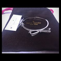 $2.99 SHIPPING! NWT Kate Spade Bangle Adorable silver Kate Spade bangle bracelet w/ clasp. Brand new with tags! Comes with a small KS jewelry bag. Retail: $58. Kate Spade Jewelry Bracelets