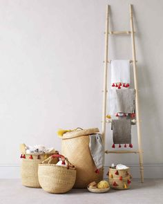 Mini tassels made of six-ply cotton embroidery floss lend a little souk chic to plain baskets and towels.