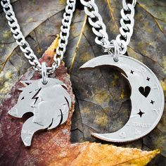 We can take a half dollar, and carefully engraving heart, stars, and wolfish lines. Then we hand cut the outline of the wolf and the crescent moon.