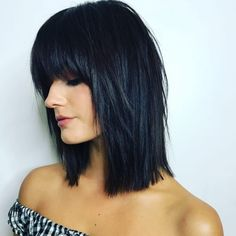 A medium layered bob with bangs for thick hair